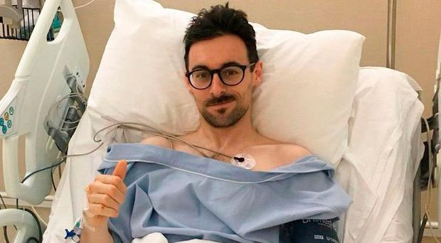 Thumbs up: Eugene Laverty recovers in hospital after his crash in Thailand on Sunday