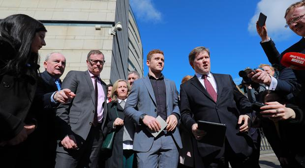 Paddy Jackson and solicitor Joe McVeigh speak to reporters outside court. (Kevin Scott)