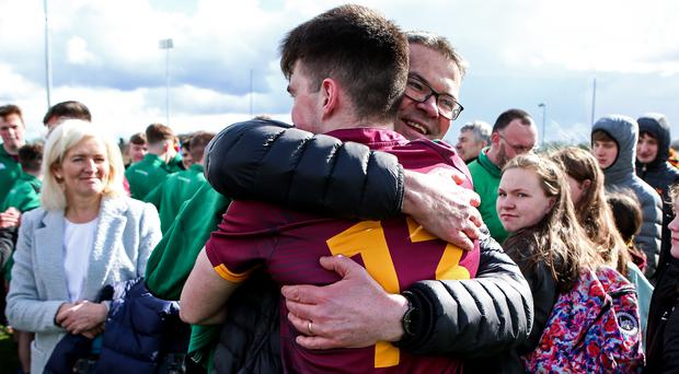 St. Ronan's Ruairi McConville celebrates with his father at full-time. Pic: INPHO/Laszlo Geczo