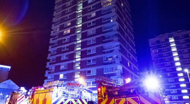Firefighters at the scene of a fire in the multi story Oisin House located in the Newlodge area of North Belfast on Wednesday. (Photo by Kevin Scott / Belfast Telegraph)