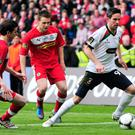 Painful memory: Cliftonville's Jaimie McGovern tracks Glentoran striker Andy Waterworth during the 2013 final
