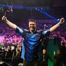 Homecoming hero: Daryl Gurney celebrates his triumph over World champion Rob Cross at the SSE Arena in Belfast