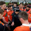 Job done: Armagh boss Kieran McGeeney addresses his team after the game