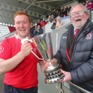 All smiles: Malone II captain Ricky Greenwood receives the McCrea Cup from Ulster Branch President Graffin Parke after their victory over Cooke in the Kingspan final