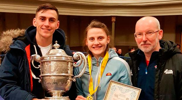 Family matters: Gold Coast-bound brother and sister Aidan and Michaela Walsh, with Monkstown ABC coach Paul Johnston