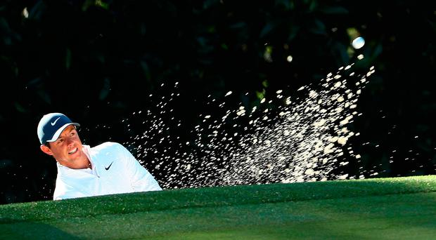 Looking good: Rory McIlroy plays out of a bunker during a practice round at Augusta National