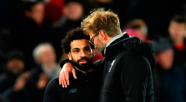 Good job: Jurgen Klopp hails goalscorer Mohamed Salah