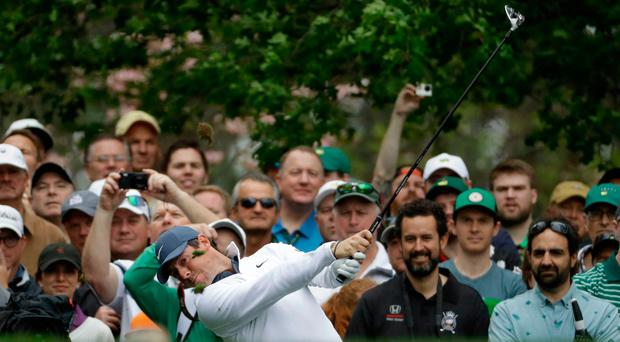 Fans' favourite: Rory McIlroy at the fourth hole during yesterday's practice round at Augusta
