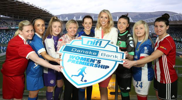 Up and running: Clare Kirkwood, Vice Chairperson of the NIFL Women's Premiership Committee (centre left) and Nicola McCleery of Danske Bank join players at the Danske Bank Women's Premiership launch last night