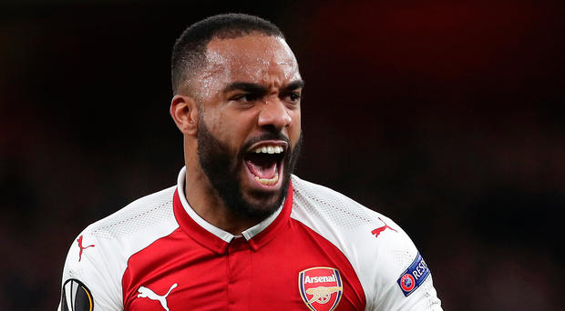 At double: Alexandre Lacazette celebrates the first of his brace