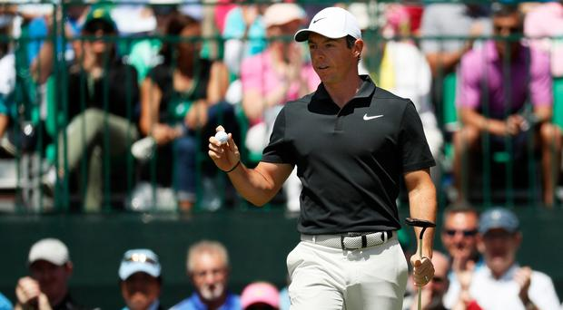 Assured: Rory McIlroy at Augusta yesterday