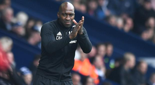 West Brom caretaker manager Darren Moore gestures on the touchline
