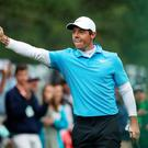 Rory McIlroy of Northern Ireland celebrates making eagle on the eighth during his third round at the Masters.