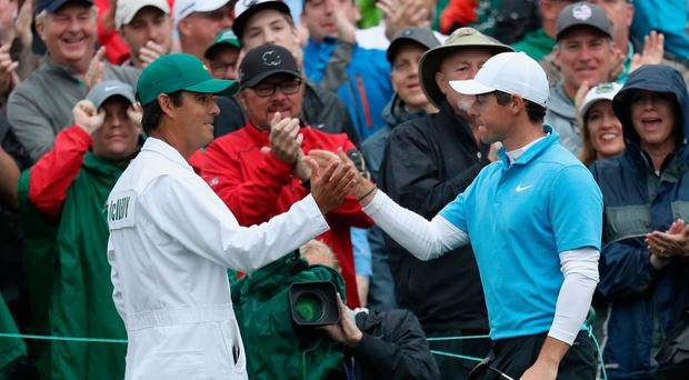 Rory McIlroy with lifelong friend and caddie Harry Diamond during the 2018 Masters at Augusta.