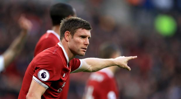 Liverpool midfielder James Milner insists a co-ordinated defensive plan can keep Manchester City at bay.