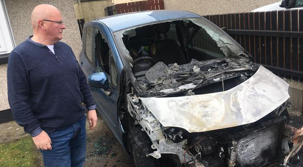 Councillor Kevin Campbell with his damaged car.