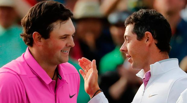 Patrick Reed, left, is congratulated by Rory McIlroy after winning the Masters.