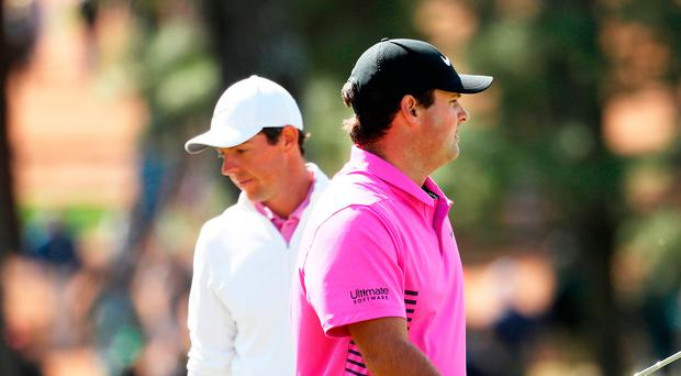 Trailing behind: Rory McIlroy could not overhaul Masters winner Patrick Reed at Augusta last night