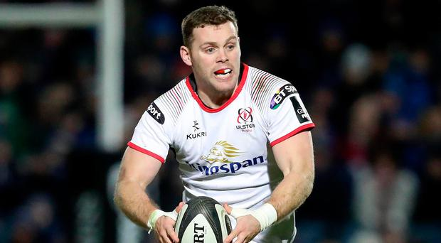 On the ball: Darren Cave was thrilled to silence some of Ulster's critics