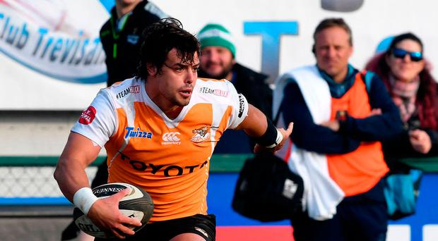 Playing catch-up: Cheetahs' Francois Venter breaks the line against Benetton Treviso in the revamped Guinness PRO14
