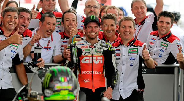 Championship leader: Cal Crutchlow all smiles yesterday