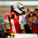 Picture perfect: Sebastien Vettel celebrates after triumphing in the Bahrain Grand Prix to extend his advantage over Lewis Hamilton in the title race to 17 points