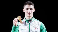Northern Ireland's Rhys McClenaghan shows off his gold medal following the Men's Pommel Horse at the Coomera Indoor Sports Centre.
