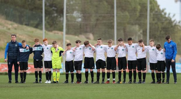Greenisland lead the minute's silence for Carter Carson before their Barcelona Cup final against Dungannon United Youth.