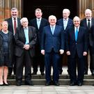 (L-R) Jonathan Powell, Monica McWilliams, Lord John Alderdice, Seamus Mallon, Lord David Trimble, Bertie Ahern, Sir Reg Empey, Senator George J. Mitchell, Paul Murphy and Gerry Adams pose for a photo on the 20th Anniversary of the signing of The Good Friday Agreement on April 10, 2018 in Belfast, Northern Ireland. The Good Friday Agreement was signed on this day 20 years ago. Northern Ireland's present devolved system of government is based on this agreement and was a major part of the 1990's peace process. (Photo by Charles McQuillan/Getty Images)