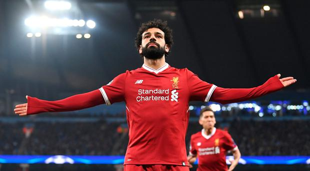Liverpool's Mohamed Salah celebrates scoring his sides first goal during the UEFA Champions League Quarter Final Second Leg match between Manchester City and Liverpool at Etihad Stadium on April 10, 2018 in Manchester, England. (Photo by Laurence Griffiths/Getty Images,)