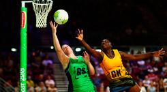 Full stretch: NI ace Lisa Bowman battles for the ball against Barbados