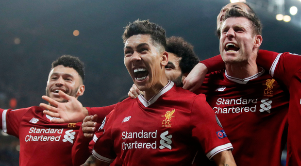 Bobby dazzler: Roberto Firmino is mobbed after scoring Liverpool's second goal to help dump Manchester City out of the Champions League