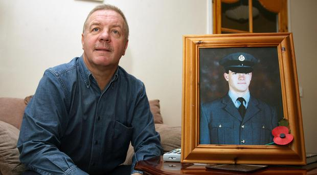 Raymond McCord, pictured alongside his son Raymond Jnr (Paul Faith/PA)