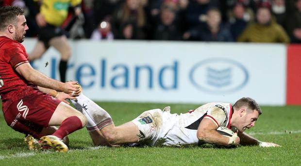 Old foes: Ulster's Darren Cave scores against Munster and the two provincial rivals will meet on the last day