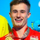 Treble chance: England's Jack Laugher with his gold medal