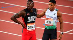 Silver medalist of Jereem Richards of Trinidad and Tobago looks on with Leon Reid of Northern Ireland after the Men's 200 metres final. (Photo by Matt Roberts/Getty Images)