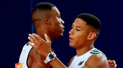 Good effort: Northern Ireland ace Leon Reid (right) embraces Zharnel Hughes, who was later disqualified