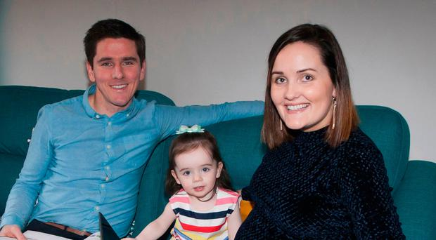 Winning combination: Gareth McGlynn at home with daughter Shea and wife Ciara