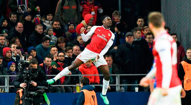 Up for it: Arsenal's Danny Welbeck celebrates his goal last night