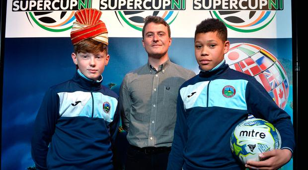 Game on: Greenisland captain Jack Patterson with team-mate Reece Black and manager Niall McGovern who are set to face some of India's top young footballers at the 2018 SuperCup NI