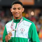 Northern Irelands Leon Reid shows off his historic bronze - Northern Ireland's first athletics medal at the Commonwealth Games in 28 years.