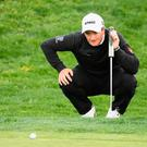 Paul Dunne lines up his putt on the eighth green during round two at the Open de Espana