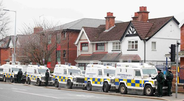 PSNI officers at the IRSP office on the Falls Road in west Belfast after police conducted a number searches throughout Belfast. Picture by Jonathan Porter/PressEye