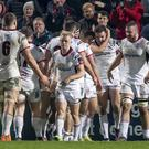 Ulster's Jacob Stockdale celebrates his late try with teammates. Pic: INPHO/Morgan Treacy