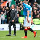 On top: Brendan Rodgers salutes the Celtic fans after victory over Rangers at Ibrox last month