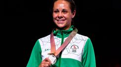 Northern Ireland's silver medallist Carly McNaul poses with her medal