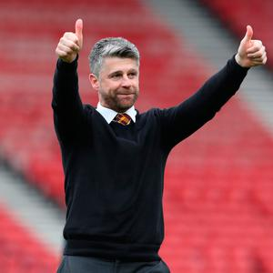 Motherwell manager Stephen Robinson celebrates at full-time after the William Hill Scottish Cup semi final.