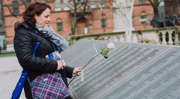 Bangor woman, Alison Kerrigan, lays a rose in memory of her great, great uncle after the Titanic Memorial Service in the grounds of Belfast City Hall. The annual event is held in memory of all those who died after RMS Titanic sank on her maiden voyage in 1912