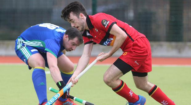 Hat-trick man: Banbridge's Johnny McKee takes on Cork C of I's Andrew Gray on his way to scoring three goals