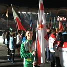 Leading by example: Gold medal winner Rhys McClenaghan carries the Northern Ireland flag at the closing ceremony of the Commonwealth Games